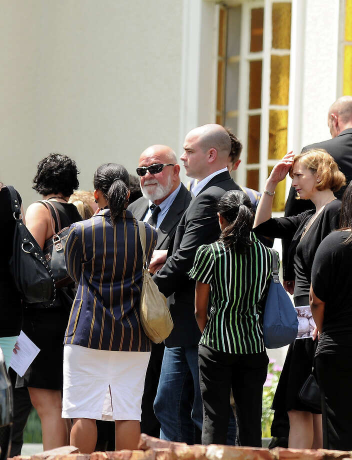 Barry Steenkamp, Reeva's father, is surrounded by family and friends as he arrives at Reeva's memorial on February 19, 2013 in Port Elizabeth, South Africa. Steenkamp was allegedly murdered by boyfriend, Oscar Pistorius on February 14, 2013. Pistorius, who has been charged with the murder, is appearing in court today for his bail hearing. Steenkamp's memorial is being held at The Victoria Park Crematorium. Photo: Gallo Images, Getty Images / 2013 Gallo Images (PTY) LTD