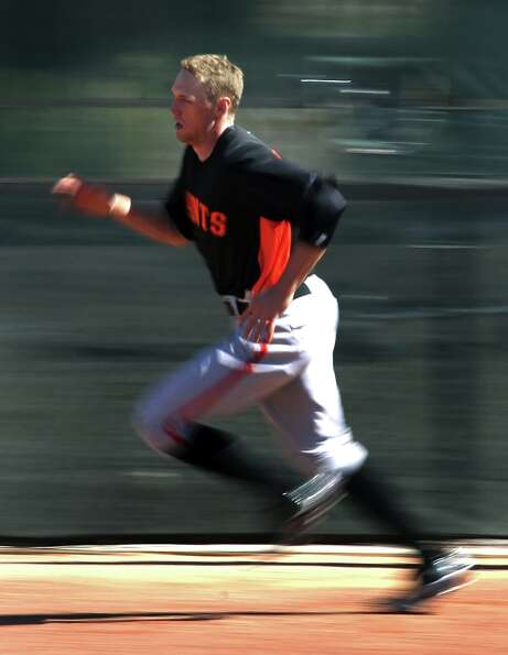 San Francisco Giants' Hunter Pence runs wind sprints during spring training Monday, Feb. 18, 2013, i