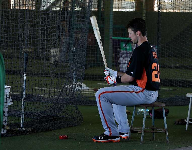 San Francisco Giants' Buster Posey waits to hit during a spring training baseball workout Saturday,