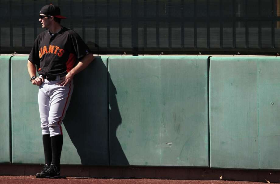 San Francisco Giants pitcher Barry Zito relaxes after running wind sprints at spring training Monday, Feb. 18, 2013, in Scottsdale, Ariz. Photo: Lance Iversen, The Chronicle / ONLINE_YES