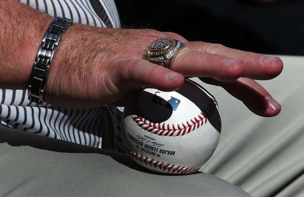 Brian Sabean rolls a baseball back and forth while watching spring training Monday, Feb. 18, 2013, in Scottsdale, Ariz. Photo: Lance Iversen, The Chronicle / ONLINE_YES