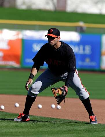 Marco Scutaro fields a ground ball during a spring training baseball workout Saturday, Feb. 16, 2013, in Scottsdale, Ariz. Photo: Darron Cummings, Associated Press / AP