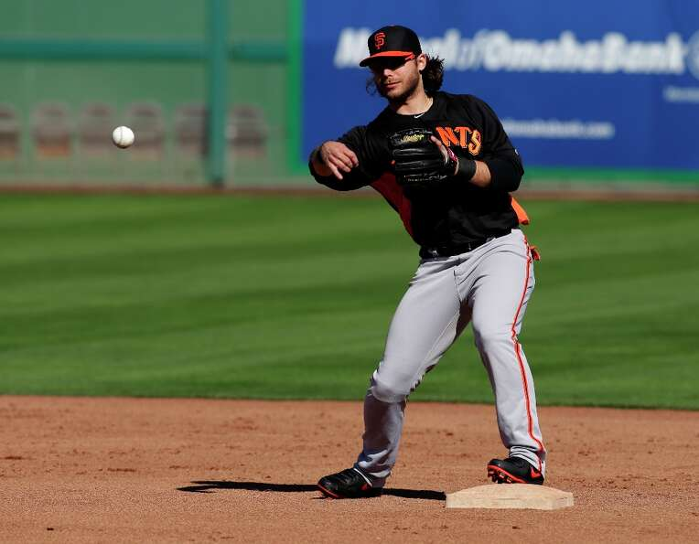 Brandon Crawford throws during a spring training baseball workout Saturday, Feb. 16, 2013, in Scotts