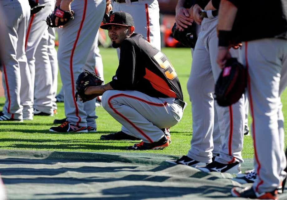 Sergio Romo watches during a drill at spring training baseball workout Saturday, Feb. 16, 2013, in Scottsdale, Ariz. Photo: Darron Cummings, Associated Press / AP