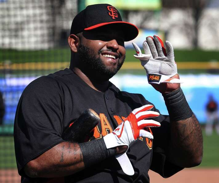 San Francisco Giants infielder Pablo Sandoval waves to fans after hitting a home run during spring t