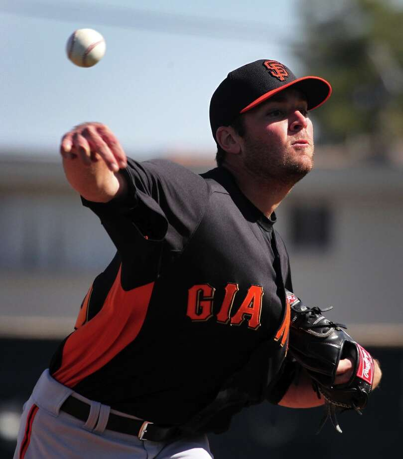 San Francisco Giants' minor league pitcher Brett Bochy, son of the San Francisco Giants manager Bruce Bochy, throws during spring training Monday, Feb. 18, 2013, in Scottsdale, Ariz. Photo: Lance Iversen, The Chronicle / ONLINE_YES