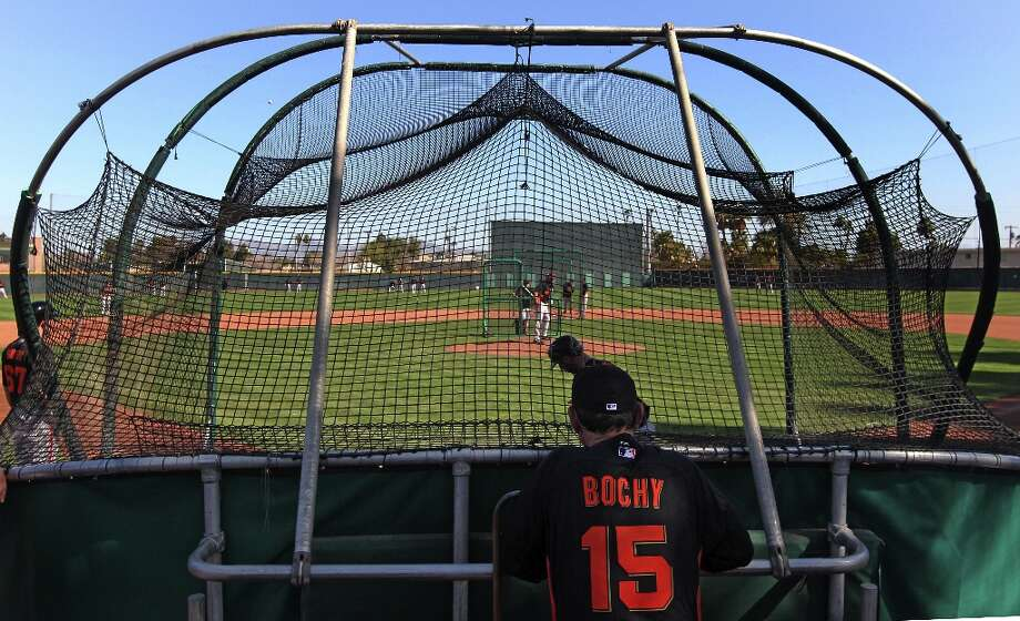 San Francisco Giants manager Bruce Bochy watches batting practice at spring training. Photo: Lance Iversen, The Chronicle / ONLINE_YES