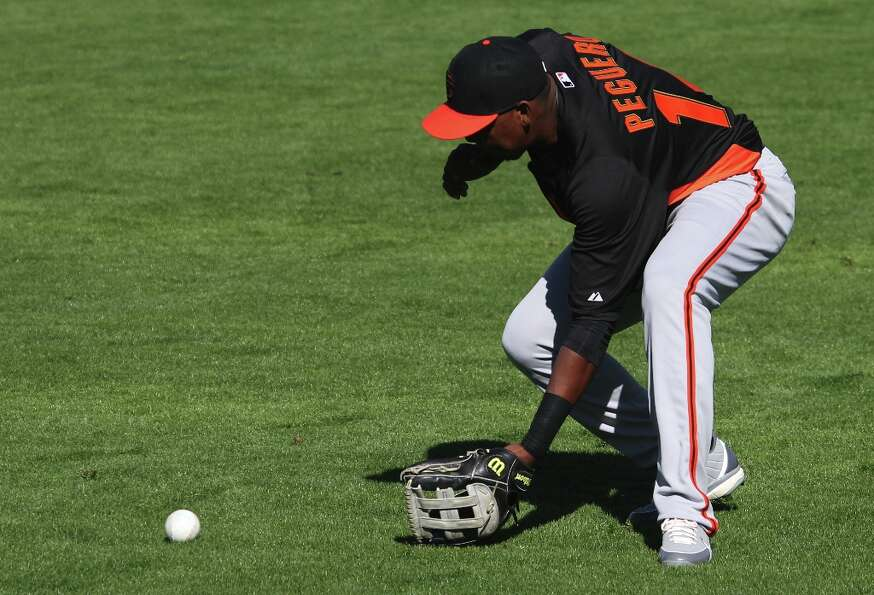 San Francisco Giants' Francisco Peguero fields a ground ball during spring training Saturday, Feb. 1