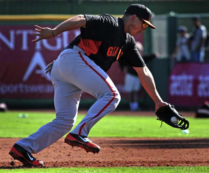 San Francisco Giants' infielder Ricky Oropesa fields a line drive during spring training Monday, Feb