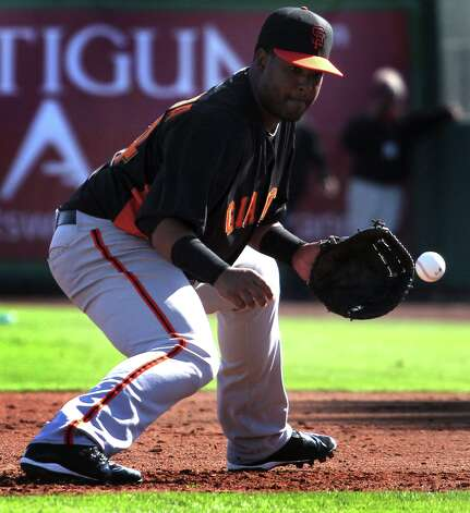 San Francisco Giants' infielder Angel Villalona fields a line drive during spring training Monday, Feb. 18, 2013, in Scottsdale, Ariz. Photo: Lance Iversen, The Chronicle / ONLINE_YES