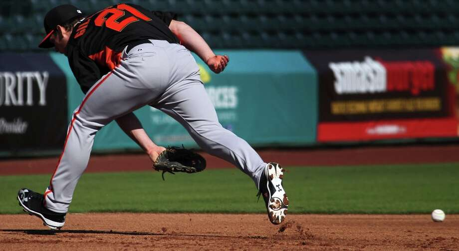 San Francisco Giants' Conor Gillaspie runs down a ground ball during spring training Monday, Feb. 18, 2013, in Scottsdale, Ariz. Photo: Lance Iversen, The Chronicle / ONLINE_YES