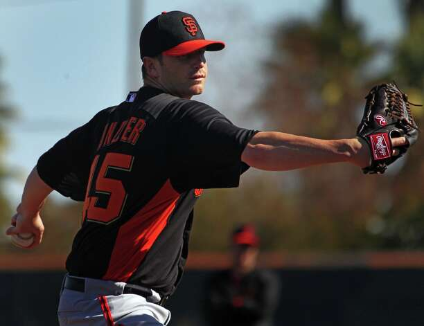 San Francisco Giants' pitcher Dan Runzler throws during warm ups at spring training Monday, Feb. 18, 2013, in Scottsdale, Ariz. Photo: Lance Iversen, The Chronicle / ONLINE_YES