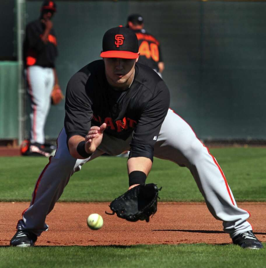 San Francisco Giants infielder Adam Duvall fields a ground ball during warm up's at spring training Monday, Feb. 18, 2013, in Scottsdale, Ariz. Photo: Lance Iversen, The Chronicle / ONLINE_YES