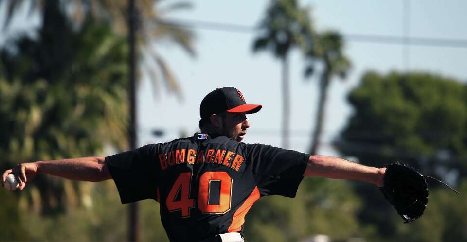 San Francisco Giants pitcher Madison Bumgarner throws during spring training Monday, Feb. 18, 2013,