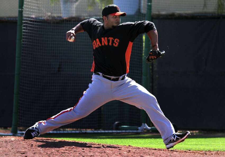San Francisco Giants' pitcher Yusmeiro Petit throws during battling practice at spring training Mond