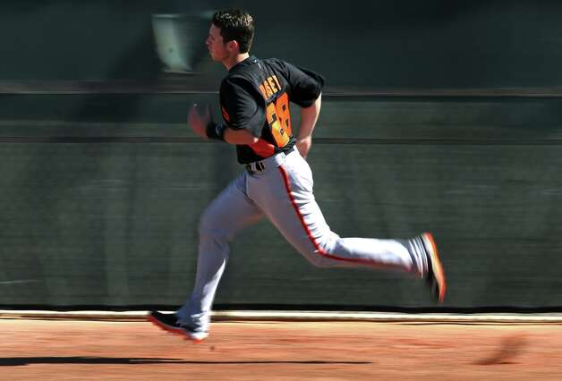 San Francisco Giants' catcher Buster Posey runs wind sprints during spring training Monday, Feb. 18, 2013, in Scottsdale, Ariz. Photo: Lance Iversen, The Chronicle / ONLINE_YES