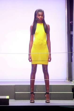 A model on the runway during the Rihanna for River Island collection show during London Fashion Week Fall/Winter 2013/14 at The Old Sorting Office on February 16, 2013 in London, England. Photo: Julian Parker, UK Press Via Getty Images / 2013 Julian Parker
