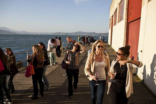 People enjoyed views of the Bay while sipping wines at the San Francisco Chronicle Wine Competition at Fort Mason in San Francisco, Calif., Saturday, February 16, 2013. Photo: Jason Henry, Special To The Chronicle