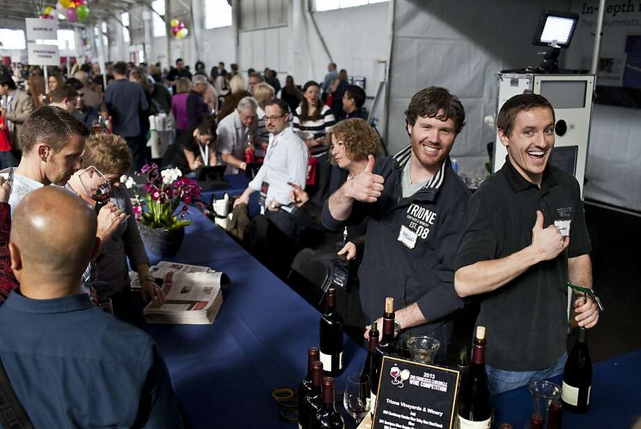 People posed for pictures with the girl with the pearl earring at the Chronicle booth at the San Francisco Chronicle Wine Competition at Fort Mason in San Francisco, Calif., Saturday, February 16, 2013. Photo: Jason Henry, Special To The Chronicle