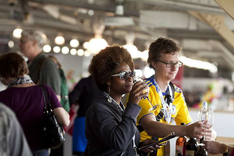 Samaki Dorsey, center, and Andy Nixon, right, tasted wines at the San Francisco Chronicle Wine Competition at Fort Mason in San Francisco, Calif., Saturday, February 16, 2013. Photo: Jason Henry, Special To The Chronicle