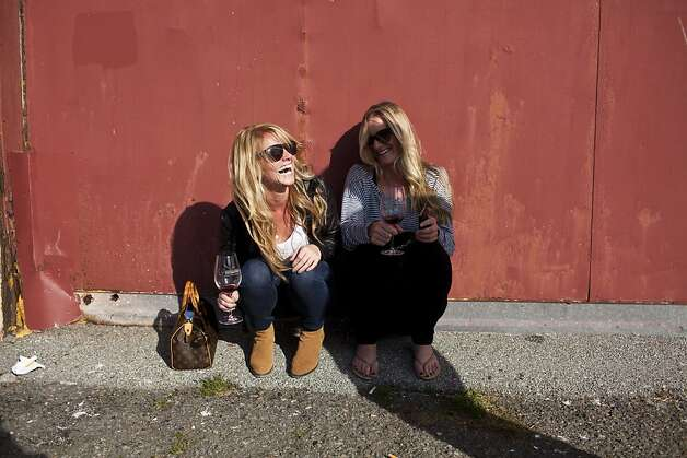 Lindsay Wright and Sarah Byrd enjoyed their wines outside the pavilion by the water at the San Francisco Chronicle Wine Competition at Fort Mason in San Francisco, Calif., Saturday, February 16, 2013. Photo: Jason Henry, Special To The Chronicle