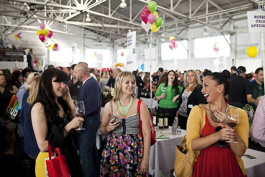 Carlene Mallet, right, Vanessa Walker, center, and Mallory Murtaugh sample wines at the San Francisco Chronicle Wine Competition at Fort Mason in San Francisco, Calif., Saturday, February 16, 2013. Photo: Jason Henry, Special To The Chronicle
