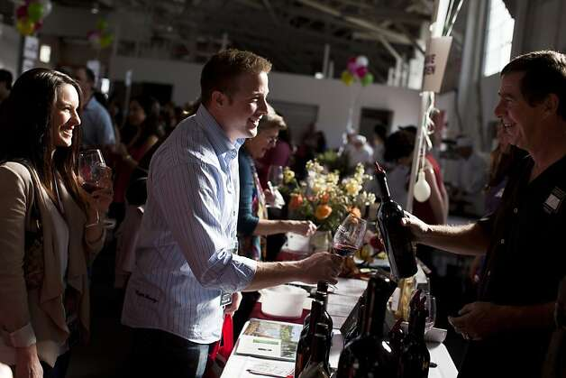Nick and Meghan Bello taste wines from Ahnfeldt Wines at at the San Francisco Chronicle Wine Competition at Fort Mason in San Francisco, Calif., Saturday, February 16, 2013. Photo: Jason Henry, Special To The Chronicle