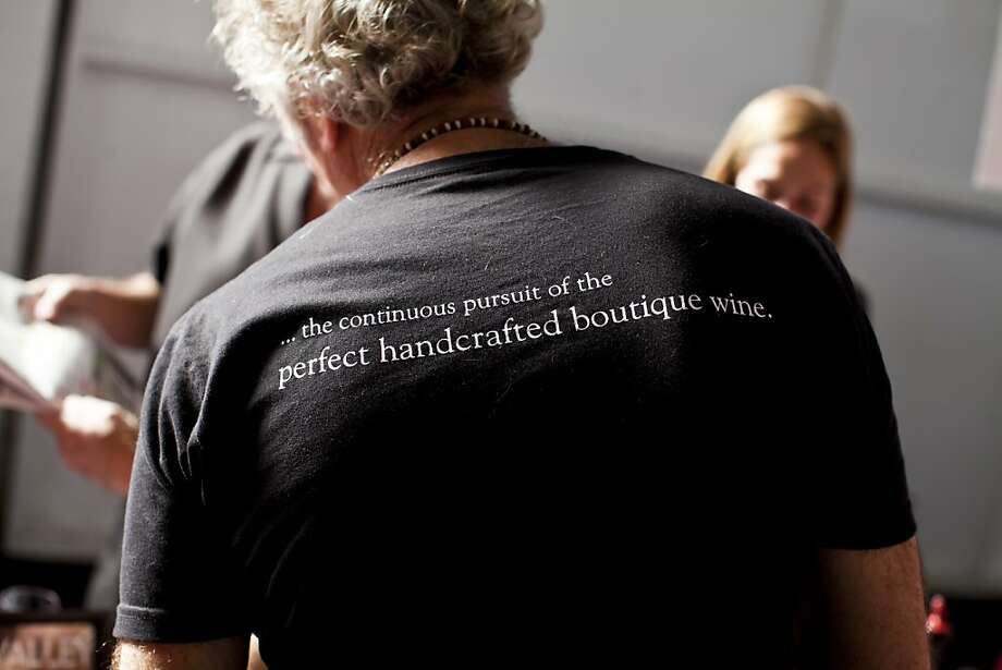John Gilpin, of Quercus Wines, wearing a t-shirt promoting boutique wines at the San Francisco Chronicle Wine Competition at Fort Mason in San Francisco, Calif., Saturday, February 16, 2013. Photo: Jason Henry, Special To The Chronicle