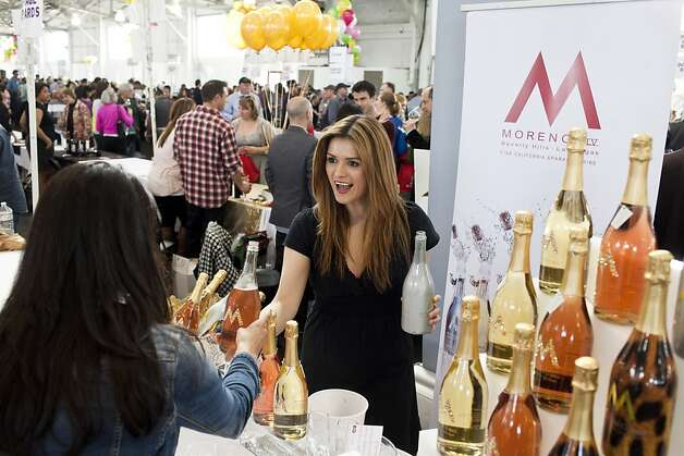 Laura Castaneda of Moreno Vineyards offers tastes of their sparkling wines at the San Francisco Chronicle Wine Competition at Fort Mason in San Francisco, Calif., Saturday, February 16, 2013. Photo: Jason Henry, Special To The Chronicle