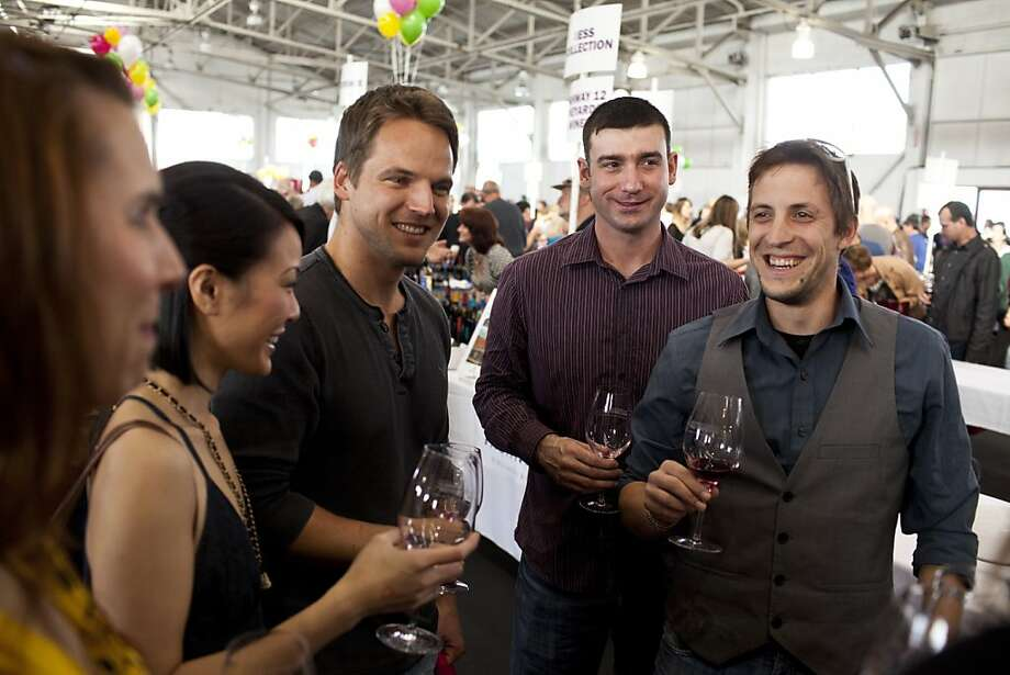 Stewart Mcilvena, Kevin Stichter, and Javier Rodriguez taste wines and chat with other attendees at the San Francisco Chronicle Wine Competition at Fort Mason in San Francisco, Calif., Saturday, February 16, 2013. Photo: Jason Henry, Special To The Chronicle