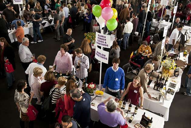 Attendees bounced around the pavilion tasting wines from different vineyards at the San Francisco Chronicle Wine Competition at Fort Mason in San Francisco, Calif., Saturday, February 16, 2013. Photo: Jason Henry, Special To The Chronicle