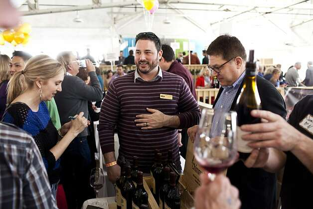 Jeff Alexander, of Chimney Rock Vineyards, offers tastes of Terlato Wines at the San Francisco Chronicle Wine Competition at Fort Mason in San Francisco, Calif., Saturday, February 16, 2013. Photo: Jason Henry, Special To The Chronicle