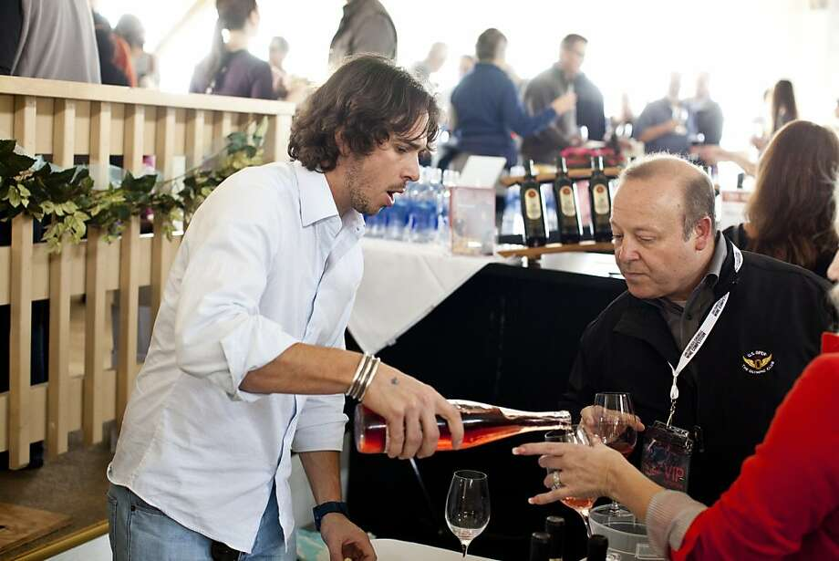 Ben Flajnik, of Envolve Winery and former competitor on the TV show The Bachelor, pours samples of his wines at the San Francisco Chronicle Wine Competition at Fort Mason in San Francisco, Calif., Saturday, February 16, 2013. Photo: Jason Henry, Special To The Chronicle