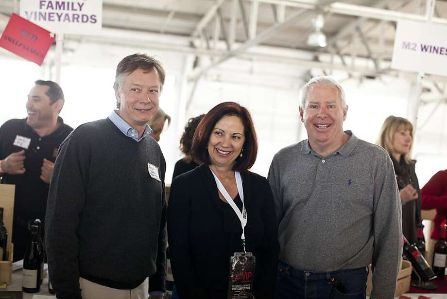 Erica Simpson, center, with Bob Fraser, right, and Bryan Parysul  at the San Francisco Chronicle Wine Competition at Fort Mason in San Francisco, Calif., Saturday, February 16, 2013. Photo: Jason Henry, Special To The Chronicle