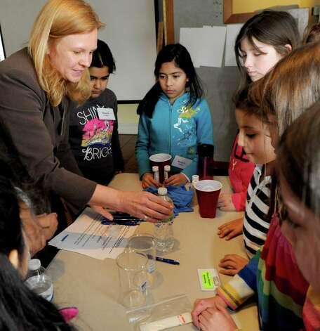Girls experiment with chromatography during a lunch and learn session with Lynda Fredette, left, at SoundWaters in Stamford on Tuesday, February 19, 2013. Photo: Lindsay Perry / Stamford Advocate