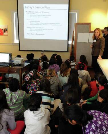 Girls listen to a presentation by Lynda Fredette of Sikorsky during a lunch and learn session at SoundWaters in Stamford on Tuesday, February 19, 2013. Photo: Lindsay Perry / Stamford Advocate