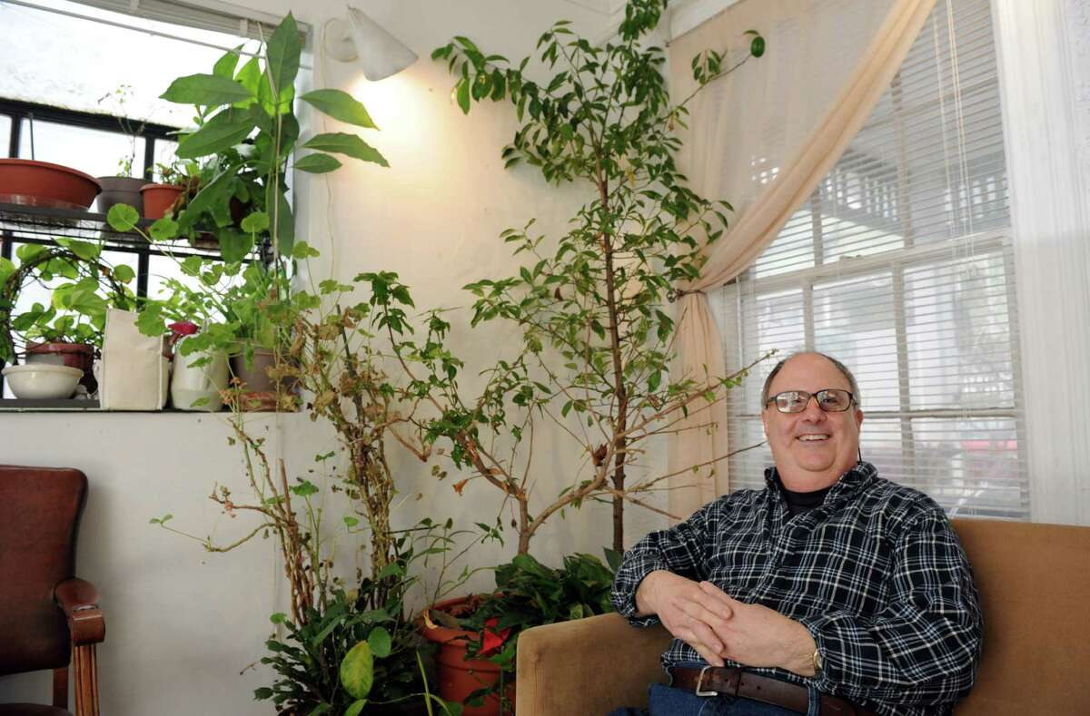 Joseph Kuntz, former lab technician for the City of Stamford's Health Department, poses for a photo in his Stamford home. Kuntz has retired after more than 30 years with the city.