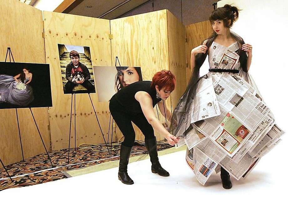 All the news that fits:Stylist Debra Folger edits Miranda Henckel's dress before Miranda circulates at the Radcon science fiction convention in Pasco, Wash. Photo: Richard Dickin, Associated Press