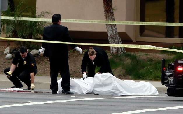 Orange County coroner's officials remove a body from the scene in Orange, Calif., Tuesday, Feb. 19, 2013. Police say a chaotic 25-minute shooting spree through Orange County left a trail of dead and injured victims before the shooter killed himself. Orange County sheriff's spokesman Jim Amormino say there are at least six crime scenes with three people, including the suspected gunman, dead and several others wounded. Tustin police Supervisor Dave Kanoti said the shootings started with an apparent carjacking just after 5 a.m. Tuesday in an unincorporated Ladera Ranch area of Orange County. (AP Photo/Jae C. Hong) Photo: Jae C. Hong