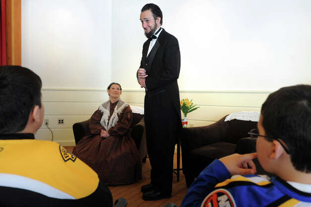 Lewis Dube, in character as President Abraham Lincoln, introduces himself to the audience at the Fairfield Museum and History Center, in Fairfield, Conn., Feb. 18th, 2013. Dube and fellow actor Carol Deloppo, in the roll of Mary Todd Lincoln, presented their program at the center Monday in honor of PresidentsâÄô Day. Photo: Ned Gerard / Connecticut Post
