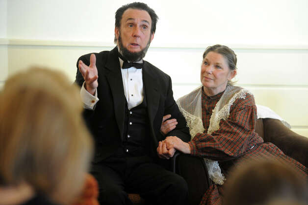 Lewis Dube, in character as President Abraham Lincoln, answers questions from the audience at the Fairfield Museum and History Center, in Fairfield, Conn., Feb. 18th, 2013. Dube and fellow actor Carol Deloppo, in the roll of Mary Todd Lincoln, presented their program at the center Monday in honor of PresidentsâÄô Day. Photo: Ned Gerard / Connecticut Post