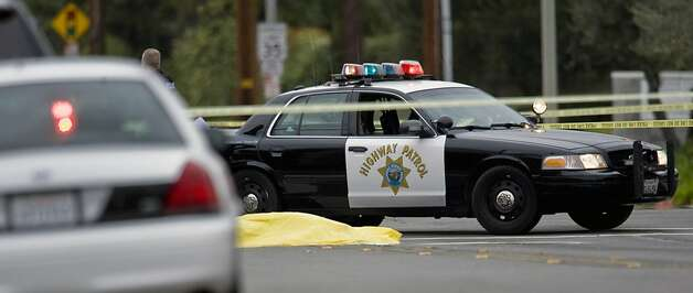 A body lays in the intersection of Wanda Road and Katella Avenue early Tuesday, Feb. 19, 2013 in Orange County, Calif.,  as local police agencies investigate the scene.  Police say a chaotic 25-minute shooting spree through Orange County left a trail of dead and injured victims before the shooter killed himself. Orange County sheriff's spokesman Jim Amormino say there are at least six crime scenes with three people, including the suspected gunman, dead and several others wounded. Tustin police Supervisor Dave Kanoti said the shootings started with an apparent carjacking just after 5 a.m. Tuesday in an unincorporated Ladera Ranch area of Orange County. Photo: Mark Rightmire, Associated Press