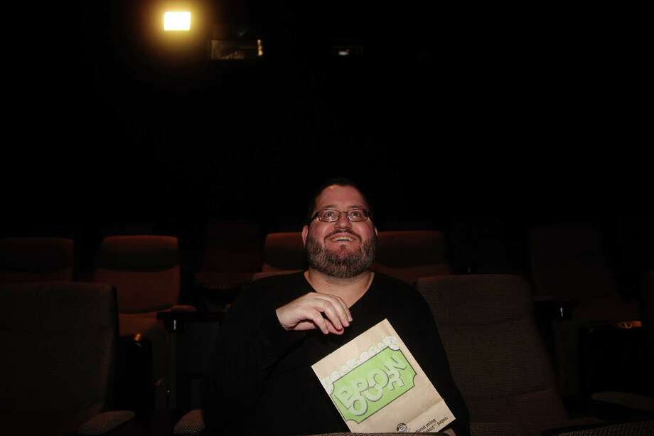 Oscar fan Eric James is a familiar face at theaters such as the Sundance Cinema. He has watched most, if not all, of this year's Oscar nominated movies. Photo: Pin Lim, Freelance / Copyright Pin Lim.