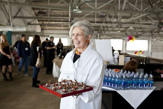 Susan Foord, of Foord Catering, holds a plate of edible gingerbread spoons with strawberries and feta cheese at the San Francisco Chronicle Wine Competition at Fort Mason in San Francisco, Calif., Saturday, February 16, 2013. Photo: Jason Henry, Special To The Chronicle