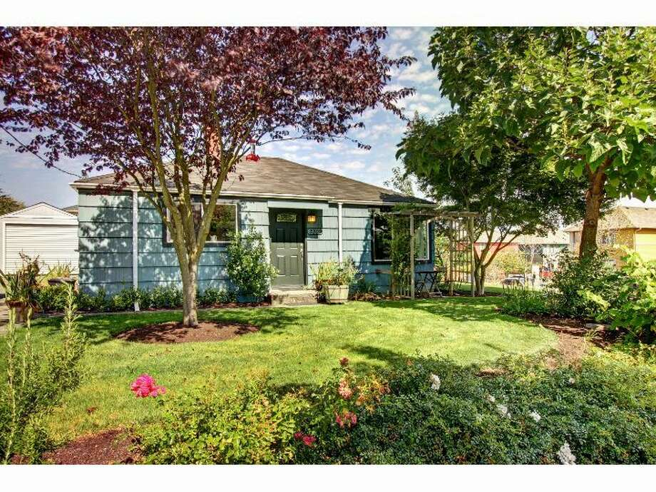 West Seattle's Delridge area has nice homes that are affordable, by Seattle standards. Here are four listed there for between $250,000 and $300,000, starting with 3202 S.W. Raymond St. The 775-square-foot house, built in 1947, has two bedrooms, one bathroom, a detatched garage and extensive gardens on a 5,280-square-foot corner lot. It's listed for $289,950, although a sale is pending. Photo: Courtesy Chuck Houston/Windermere Real Estate