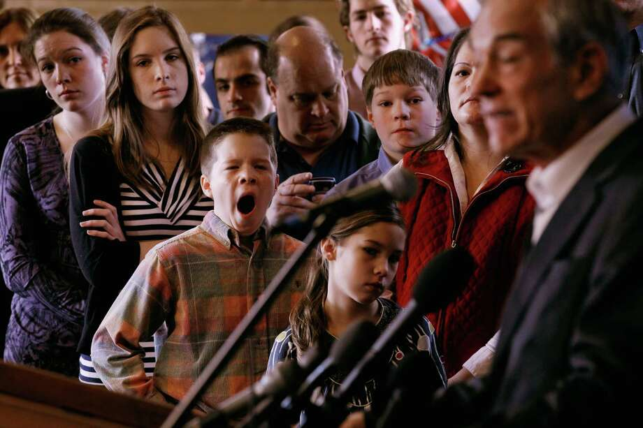 Members of the Peik family Kristen, 20; Katie, 18; Stephen, 13; Teresa and twin brother Alex, 10, listen to Ron Paul address a group of home-school supporters at the Lawrence Barn on the day before the state primary January 9, 2012 in Hollis, N.H. Photo: Chip Somodevilla, Getty Images / 2012 Getty Images