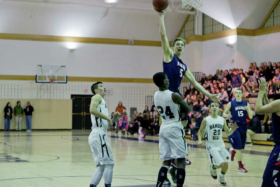 Greens Farms Academy senior guard Hunter Eggers drives to the basket during the Dragons' 80-61 win over Hamden Hall on Feb. 1. Eggers scored a season-high 29 points in an 89-57 win over St. Luke's on Feb. 16. Photo: Contributed Photo / Norwalk Citizen