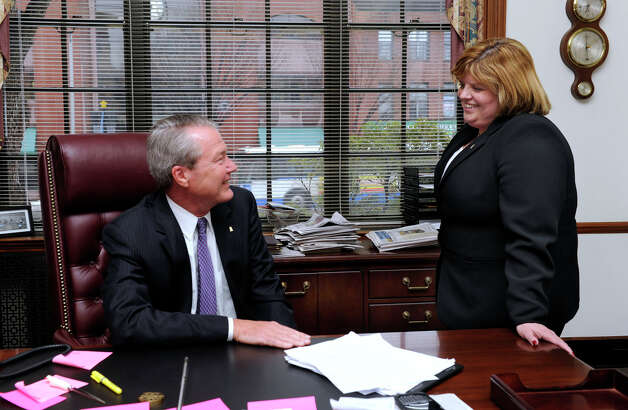 Hal Wibling, left, who is retiring as president and CEO of the Savings Bank of Danbury, meets with Kathleen Romagnano, currently executive vice president and COO, in his office Tuesday, Feb. 19, 2013. She will be replacing Wibling. Photo: Carol Kaliff / The News-Times