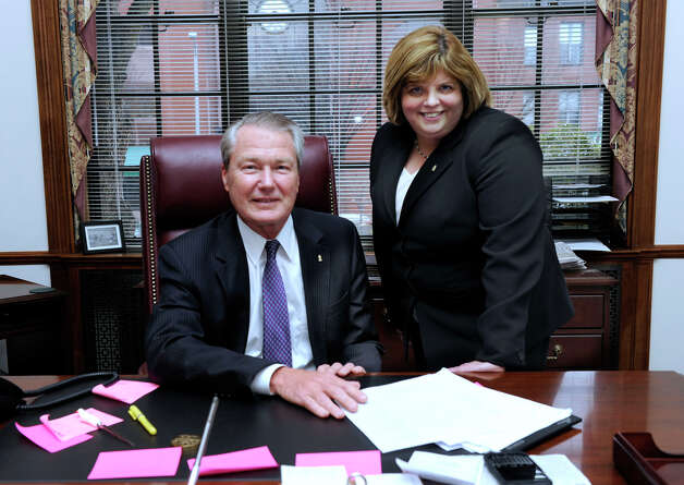 Hal Wibling, left, who is retiring as president and CEO of the Savings Bank of Danbury, and Kathleen Romagnano, currently executive vice president and COO, are photographed in his office Tuesday, Feb. 19, 2013. Romagnano will be replacing Wibling. Photo: Carol Kaliff / The News-Times