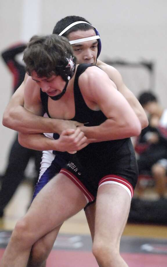 SPC wrestling championsBen Stein (black with red stripes), St. John's (138-pound class) Photo: Tony Bullard / Credit: for the Chronicle